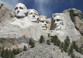 Of the four US Presidents whose faces are sculpted on Mount Rushmore, which one has a moustache?
